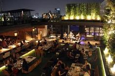 park society rooftop bar A terrace is an oasis of well-being and belongs in e… Rooftop Restaurant, Rooftop Bar, Pond Video, Pond Kits, Diy Pond, Wooden Terrace, Cruise Vacation, Vacations, Pond Design