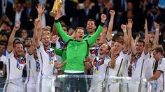 Manuel Neuer of Germany lifts the World Cup trophy to celebrate with his teammates