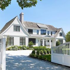 Nantucket style home with a cedar shingle and stone exterior. Beautiful windows and doors, copper gutters.it's all stunning! Nantucket Style Homes, Nantucket Home, Modern Farmhouse Exterior, Farmhouse Style, Style At Home, Traditional Style Homes, Entry Gates, White Houses, House Goals
