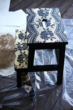 Lace spray painted stool (spray it navy, lay lace, spray over lace where you want it white). Very crisp and pretty!