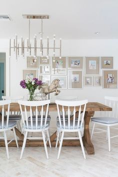 Gallery wall with beige mattes in a room designed by Lischkoff Design Planning (via House of Turquoise).