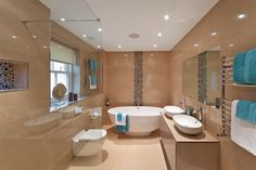 I love the mosaic tile/rock on the walls. and the round tub and sinks.