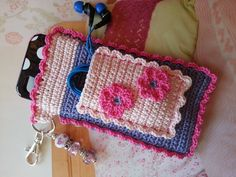 "Pink and Blue Dolled Up ""Bloomer"" Crochet Case with Beaded Keychain for iPhone, Camera, Smart Phone, MP3 Player. $25,00, via Etsy."