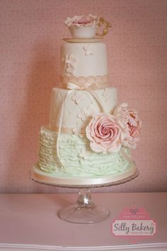 vintage mint wedding cake with pink sugar flowers