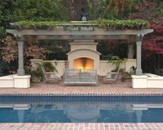 I want a Gazebo simular to this on the other side of the pool either between the oaks or in front of the pine.: