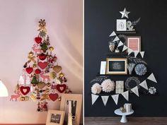 árvore de natal feita com enfeites da árvore colados na parede.