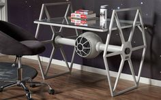 your geeky pad some Empire inspired flair with this Star Wars tie fighter desk. The tie-fighter shaped powder steel base sports a neutral grey finish and holds up a sunken tempered glass top ideal for work or displaying your Star Wars memorabilia. Star Wars Decor, Decoration Star Wars, Star Wars Furniture, Geek Furniture, Cardboard Furniture, Furniture Layout, Furniture Arrangement, Furniture Styles, Star Wars Memorabilia