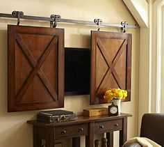 DIY it with old cabinet doors. Chalkboard paint on the cabinet doors for some extra character - Rolling Cabinet Media Solution Deco Tv, Tv Covers, Hidden Tv, Sliding Barn Door Hardware, Sliding Doors, Gate Hardware, Door Hinges, Cabinet Hardware, Door Latch