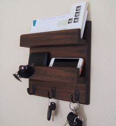 Key Hooks and mail storage keep you stylishly organized! Our handcrafted double mail ledge and key rack entryway organizer is a solution to time wasted looking for your lost keys! Perfect for mail, keys, coats, backpacks and other necessities. This custom built flush-mount organizer is made using solid wood (pictured in Java) and can be stained or painted to fit your style. Three single hooks provide storage for your keys, bags, backpacks and other necessities...and theyre even strong…