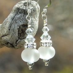 Just like their name implies, the STAR SHINE handmade earrings are sparkling and magical, exquisite accents for a bride to wear on her wedding day. The unique earrings were created with artisan made lampwork clear glass beads with a velvety frosted sea glass look.