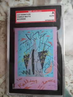 CHARLIE WATTS-ROLLING STONES DRUMMER- AUTOGRAPHED/SIGNED CUT # 3  -SGC-
