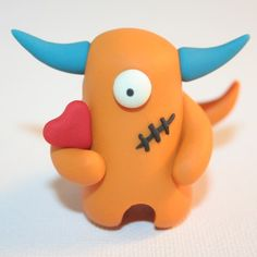 Polymer clay.  Mine would never look that 'nice' but very cute!  Reminds me of Ugly Dolls.