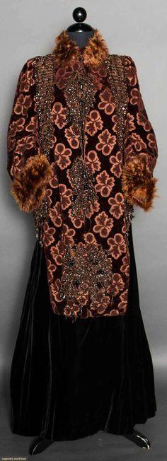 "CUT VELVET DOLMAN MANTLE, 1880 Chestnut brown velvet cut to leaf shapes, lavishly trimmed w/ fringed carnival glass beading, neck & dolman sleeves trimmed in brown maribou feathers, brown silk lining, CFL 36"", CBL 19"""