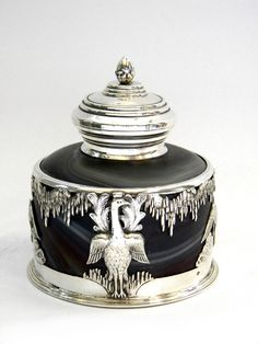 ANTIQUE FRENCH SOLID SILVER & GLASS INKWELL c. 1890 -- A gorgeous French Antique Solid Silver Mounted Inkwell with beautiful swirled glass in delicate greens and browns designed to simulate agate. The Silver receiver stand features four chased swans on various poses.The Inkwell has a Silver Hinged Lid and mounted neck. The Inkstand has a removable glass well.