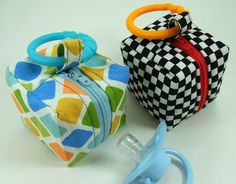 """This is a zippered pacifier pouch that I made recently. It is very small, only 2 1/2"""" cubed.  It is completely lined with no exposed seams on the inside, so no fraying.  This tutorial is available..."""