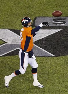 EAST RUTHERFORD, NJ - FEBRUARY 02: Quarterback Peyton Manning #18 of the Denver Broncos during Super Bowl XLVIII against the Seattle Seahawks at MetLife Stadium on February 2, 2014 in East Rutherford, New Jersey. (Photo by Jeff Zelevansky/Getty Images)