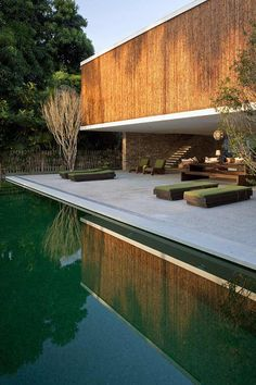House with bamboo siding and calming reflection pool - Ilhabela, Sao Paulo, Brazil, by Marcio Kogan. It so simplistic and nice Residential Architecture, Amazing Architecture, Contemporary Architecture, Interior Architecture, Chinese Architecture, Futuristic Architecture, Amazing Swimming Pools, Backyard, Patio