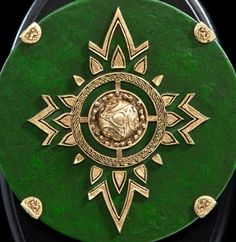 THE LORD OF THE RINGS : ROHIRRIM ROYAL GUARD'S MINIATURE SHIELD