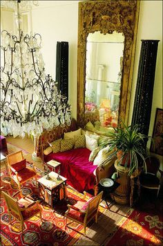 Loulou de la Falaise's salon in her apartment in Paris. The 100-candle chandelier was a wedding gift from Yves Saint Laurent and Pierre Berge. Photo by Francois Halard.