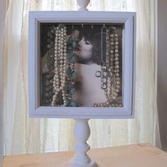shadowbox jewelry holder.. should be pretty simple to make!