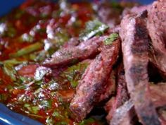Get Grilled Skirt Steak with Green and Smokey Red Chimichurri Recipe from Food Network