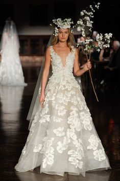 8f770ae79b92   Heavy Embellishments Designers weren t shy about covering wedding dresses  in oversized