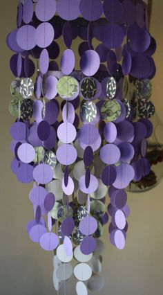 Floral print, purple, and tan paper chandelier or mobile.