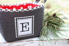 Monogram basket – pattern, fabric, and letter are sold on Etsy