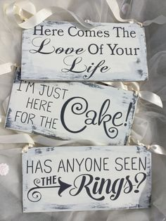 Hi my name is Kerri and Im offering this set of 3ring bearer signs that I have made by hand. Rustic sweetness. Gray peaks thru the Ivory top coat and they feature charcoal graylettering.  Do you have 3cutie pies that all want to have something to carry?.... Here ya go!  Ivory ribbon hangers are the perfect touch for outdoor weddings, beach weddings, woodland weddings, barn weddings...you name it.  I work very hard to offer you unique, fun and stylish signs that arrive on time and that you…