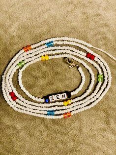 White chakra Waist Beads with all 7 chakra Colors to wear around your Waist or as a Belly chain. This is an Adornment, Body Jewelry to keep Positive Energy Flowing. African Fashion Traditional, African American Fashion, Gold Letters, White Letters, Modern Street Style, Street Styles, Chakra Colors, Body Jewelry, Unique Jewelry