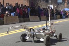 An MIT Robotics Team rover competed in a fundraising robot road race featuring over two dozen robotic machines of varying shapes and sizes.