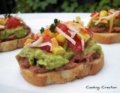 Southwestern Bruschetta...French baguette, sliced  Refried beans   Guacamole    Tomato, chopped   Corn  Shredded cheddar jack cheese