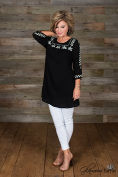 Amelia Tunic is adorable! This black peasant style tunic has a round neckline, 3/4 mini-bell sleeves and a shift style silhouette.