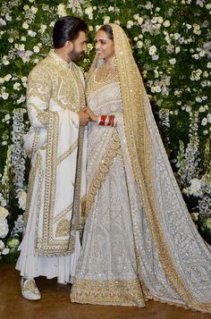 Ranveer Singh, Deepika Padukone ooze royalty at their Mumbai wedding reception Designer Bollywood style clothing Indian Bridal Outfits, Indian Bridal Fashion, Pakistani Bridal Wear, Indian Fashion Dresses, Couple Wedding Dress, Desi Wedding Dresses, Asian Wedding Dress, Indian Reception Outfit, Wedding Sari