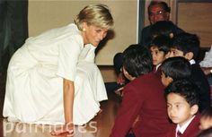 Diana, Princess of Wales visits children at the Shri Swaminararyan Hindu Mission Temple in Neasden, North London. The temple is the largest outside of India.