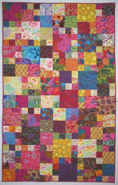 "Exuberant Color: Quilts with Kaffe Fassett Fabric  3"", 6"" and 9"" finished squares with a layout furnished in one of Kaffe Fassett's books.  This one was finished in June 2011."