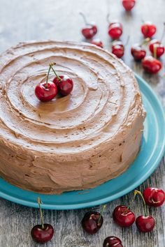 Decadent but simple chocolate cherry cake. Kirsch and cherries amplify chocolate in an intense and delicious way. The moist filling will surprise you!