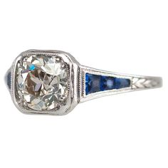 Stunning Diamond Ring with Sapphire Accents
