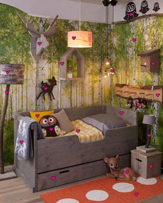 Awesome bed for a boy. The company is out of the Netherlands, but it gives a good idea how to incorporate owls, deers, the forest, etc.