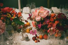 Flowers | Amy Merrick  OH GLORY. This table setting-- a study in mid-summer, what with the perfect peaches, cherries, and that ecstatic, last-gasp-of-peony season peony. But can totally translate this to fall: use pomegranate fruits and seeds in place of summer fruits. Burgundy-black dahlias instead of peonies. Cosmos flower-- either punchy-pink for spunk or chocolate for subdued elegance. And candles, for any season. Yes.