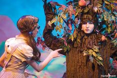 Larsen, as Dorothy, tries to pick apples off an enchanted apple tree ...