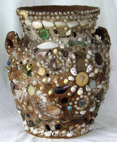 Might try making a Memory Jug.  Like doing a mosaic with buttons, coins, shells, beads, old jewelry, pretty stones, watch findings, or any other small, firm object.