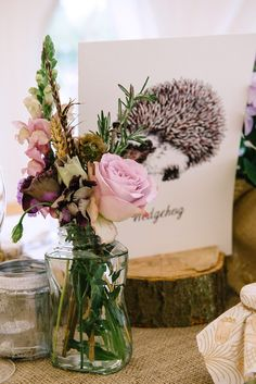 Pretty pale pink and lavender flowers in a jar, from 'A Downton Abbey, Edwardian Garden Party Inspired Wedding'  Photography http://www.julieanneimages.com/