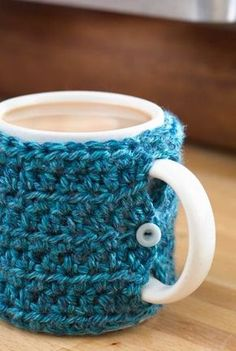 They have a crochet pattern for this mug cozy!) Check out this pattern for a One Stitch Crochet Mug Cozy - easy, stash buster and Christmas gift. Crochet Coffee Cozy, Crochet Cozy, Crochet Gifts, Free Crochet, Coffee Cup Cozy, Coffee Cups, Yarn Projects, Knitting Projects, Crochet Projects