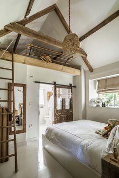 love this white modern rustic country farmhouse bedroom with rustic wooden beams reclaimed wooden ladder and sliding bathroom door and simple white painted floor. Click through for more modern rustic farmhouse interiors ideas you'll love - July 27 2019 at Modern Rustic Furniture, Modern Rustic Decor, Modern Rustic Interiors, Modern Interior Design, Home Furniture, Country Interiors, Country Furniture, Bedroom Furniture, Furniture Design