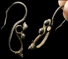 Ancient Rome, c. 1st century BCE-1st century CE. Ornate silver earring. 38 mm, 1.79 g. Earthen deposits on surfaces. ex-Los Angeles CA private collection.