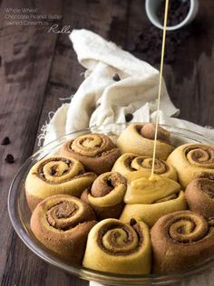 Skinny Chocolate Peanut Butter Swirled Cinnamon Buns -  These cinnamon buns are whole wheat and made with Greek yogurt to keep them so light and fluffy! You would never know that they are skinny! You're gonna LOVE them!   Foodfaithfitness.com   @FoodFaithFit