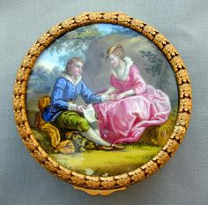 "An exquisite Louis XVI style master snuff box, the hinged cover featuring a miniature, hand-painted pastoral scene on porcelain, encircled by a gilt bronze rim, above a similar bronze base with lock, the sides decorated in raised, stylized acanthus leaves. Interior fitted with silk, unmarked, possibly Sevres. Note an unglazed fleck at bottom of portraiture, in the original firing. CIRCA DATA: 1840 DIMENSIONS: 1.50"" h x 4.25"" d PRICE: $2,000"
