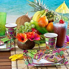 Channel island life with a tiki-tastic tablescape! Floral-printed luau plates, cups, napkins and tropical drinks create a look beach bums will love!