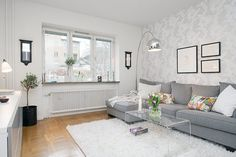 Small Swedish Apartment for Simple and Single Person: White-Wall-Small-Mirror-Grey-Sofa-Acrylic-table – All about Home design